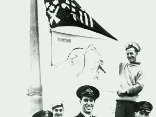 Stork_and_Jolly_Roger_flags_flown_by_HMS